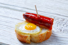Pinchos pintxos chistorra with quail egg tapas Stock Photography