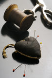 Pincushion. Tailor's tools - pincushion, scissors and a spool of thread Royalty Free Stock Photo