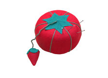 Pincushion. An isolated image of a bright red tomato and strawberry pincushion Royalty Free Stock Photography