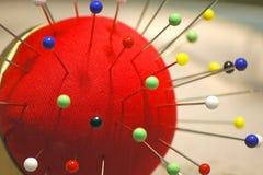 Pincushion. Macro of pincushion with colorful pins Stock Photos