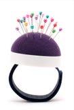 Pincushion bracelet. Purple pincushion bracelet with pins  isolated on white Stock Images
