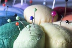 Pincushion. Closeup of a pincushion with colorfull pins Royalty Free Stock Photos