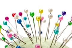 Pincushion full with colorful pins Royalty Free Stock Image