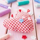 Pincushion in a heart shape Royalty Free Stock Photos