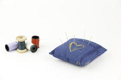 Pincushion with needle and threads Royalty Free Stock Photos