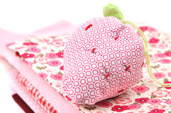 Pincushion on a Pile of Textile Royalty Free Stock Photography