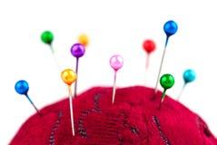Pincushion with pins closeup Stock Photo