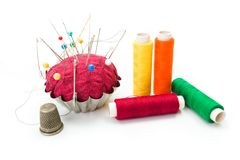 Pincushion, thimble and threads Royalty Free Stock Photos
