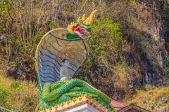 Pindaya caves legend. PINDAYA, MYANMAR - FEBRUARY 27: Representation of the legend at the entrance pilgrimage caves where young Prince Kummabhaya killed giant Stock Photo