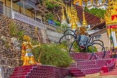 Pindaya caves legend. PINDAYA, MYANMAR - FEBRUARY 27: Representation of the legend at the entrance pilgrimage caves where young Prince Kummabhaya killed giant Stock Photography