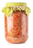 Pindjur - sallad med grillad aubergine, tomater och söt peppar Arkivfoto