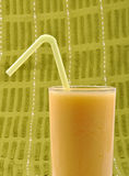 Pine apple. Juice in glass against green cloth Royalty Free Stock Photography