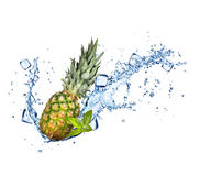 Pine-apple in water splashes on white Royalty Free Stock Photo