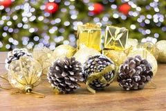 Pine ball and christmas gifts Royalty Free Stock Photos