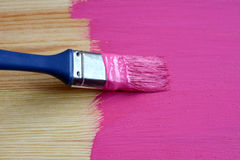 Pine board being painted Royalty Free Stock Photos