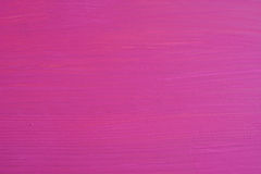 Pine board painted pink, visible wood grain Royalty Free Stock Photos