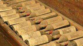 Vintage Wine Bottles. Pine box filled with dusty vintage wine bottles at Verazzano Winery in Italy royalty free stock image