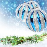 Pine branch and blue Christmas balls. Pine branch and Christmas balls on blue background Stock Photography