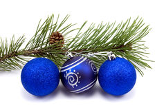 Pine branch and christmas baubles Royalty Free Stock Image