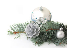 Pine branch and christmas silver decorations Royalty Free Stock Image