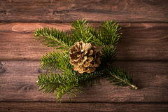 Pine branch and cone on a wooden background. Christmas decoration Royalty Free Stock Images