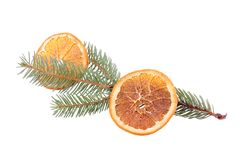 Pine branch with dried orange slice isolated Stock Photo
