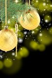 Pine branch with golden Christmas balls. Royalty Free Stock Photography