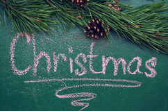 Pine branch and an inscription on a slate chalkboard Royalty Free Stock Images
