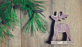 Pine branch and toy on a wooden boards Royalty Free Stock Photography