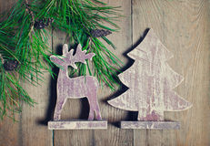 Pine branch and toys on a wooden boards Royalty Free Stock Photography