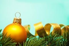 Pine branches and christmas ball Stock Image