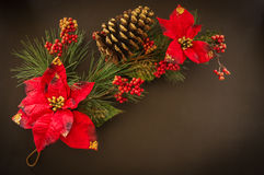 Pine branches with Christmas and New Year decorations. On a black background stock photo