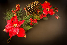 Pine branches with Christmas and New Year decorations. On a black background royalty free stock photography