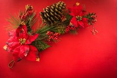 Pine branches with Christmas and New Year decorations. On a red background royalty free stock photography