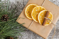 Pine branches, craft gift, dried oranges, cinnamon, top view Stock Photos