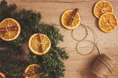 Pine branches, dried oranges, cinnamon, make decor effect  Stock Photos