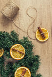 Pine branches, dried oranges, cinnamon, make decor effect  Stock Images