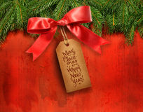 Pine branches with gift tag Stock Photo