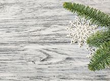 Pine branches and snowflakes closeup on vintage wooden background royalty free stock photos