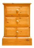 Pine chest of drawers isolated. A pine chest of drawers isolated against white Royalty Free Stock Photography