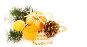 Pine  and Christmas gold decorations Stock Images