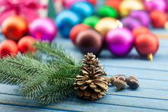 Pine cone and acorns with Christmas toys Stock Photos