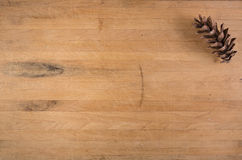 Pine Cone on Butcher Block Royalty Free Stock Images