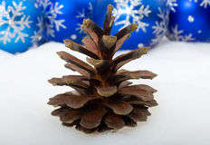 Pine cone and christmas decorations Royalty Free Stock Image