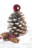 Pine cone Christmas tree and cinnamon sticks. Royalty Free Stock Photos
