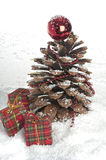 Pine cone Christmas tree and cinnamon sticks. Royalty Free Stock Image