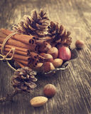 Pine cone, cinnamon and nuts for Christmas decoration Royalty Free Stock Image