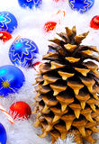 Pine Cone and Decorations. Pine cone with decorations photographed for Christmas project Stock Photos