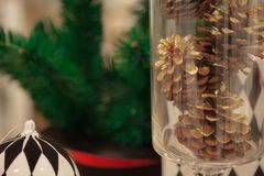 Pine cone and decorations Christmas items are arrange and decorated with beautiful objects. Royalty Free Stock Photo