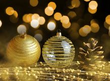 Pine cone and golden Christmas ornaments. Stock Photo